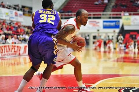 John Fraley drives around Tennessee Tech's Bassey Inameti towards the basket Thursday night. Fraley had a 31 point career performance. He also grabbed 17 rebounds. Austin Peay Men's Basketball.