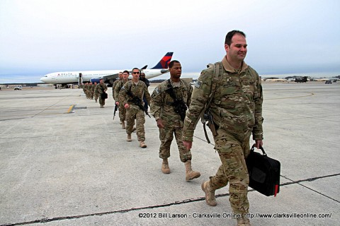 Soldier's walk to the hanger after disembarking from the aircraft