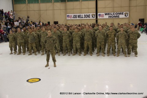 The returning soldiers stand proudly before their loved ones and friends