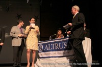 Henry Martin from Stone, Rudolph, and Martin CPAs presents the winners to hosts Cydney Miller and Rick Marino
