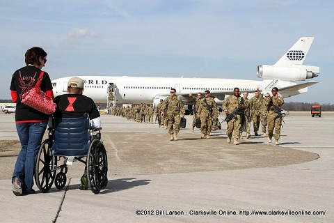 CWO Kevin Howie and his wife watch as his fellow soldiers return home safely