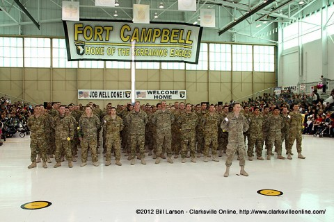 The returning Soldiers stand proudly before their families and loved ones