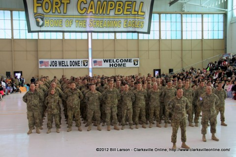The newly returned soldiers stand before their families and loved ones