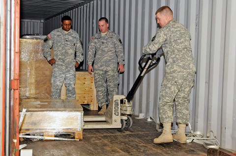 Spc. Eric Dorough, who works in storage at the 101st Sustainment Brigade Supply Support Activity, with the 305th Quartermaster Company, 129th Combat Sustainment Support Battalion, 101st Sust. Bde., pulls pieces of the new lift systems for the SSA. The two new automated units will expand the space for storage and cut down on time spent looking for parts and supplies. (Photo by Spc. Michael Vanpool)