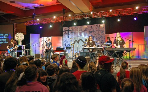 Members of the Marked Praise Band (from left, Zach Pine, Webb Booth, Myndi Leazer, Austin Robertson and Ally Robertson) perform in front of more 2,000 participants at the Warmth in Winter youth ministry conference held Jan. 28th in Murfreesboro, TN. (Photo by Melony Shemberger)