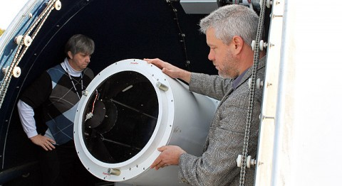 NASA's Jan McGarry (left) and Stephen Merkowitz stand next to the Next-Generation Satellite Laser Ranging (NGSLR) system, one of the ground stations that makes up the quadrangle of instruments known as the Space Geodesy project, as it peeks through the station's open dome. The NGSLR laser ranges to Earth-orbiting satellites and to NASA's Lunar Reconnaissance Orbiter. McGarry leads the development of the NGSLR and Merkowitz is the project manager for the Space Geodesy project. (Image Credit: NASA/GSFC/Elizabeth Zubritsky)