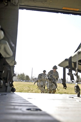 Soldiers of the 3rd Platoon, Company A, 1st Squadron, 32nd Cavalry Regiment, 1st Brigade Combat Team, 101st Airborne Division, head to the helicopter to load up for their air assault, here, at Johnson Field, Feb. 22nd. This is their first air assault as a platoon since they returned from Afghanistan in 2011. (Photo by Sgt. Richard Daniels Jr.)