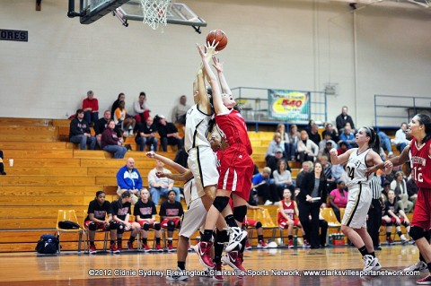 Janie White goes up for a backwards rebound over Mt. Juliet. Mt. Juliet beat Rossview 68-38 in the second night of the women's 5-AAA Region Tournament.