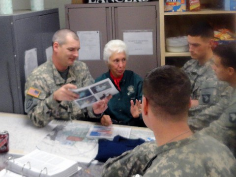 Wally Funk teaches aviators from B Company, 5th Battalion, 101st Combat Aviation Brigade about pre-mission planning, Jan. 12th, at Fort Campbell, KY. Funk stressed the importance of planning as she has observed many aviation accidents which occurred due to a lack of proper planning. (U.S. Army Photo by Chief Warrant Officer 2 James Barnes, 101st Combat Aviation Brigade)