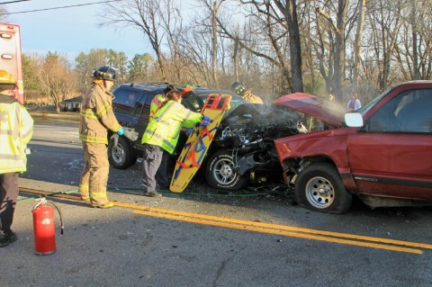 Emergency personel work to free one of the accidents victims from the wreckage. (Photo by CPD-Jim Knoll)