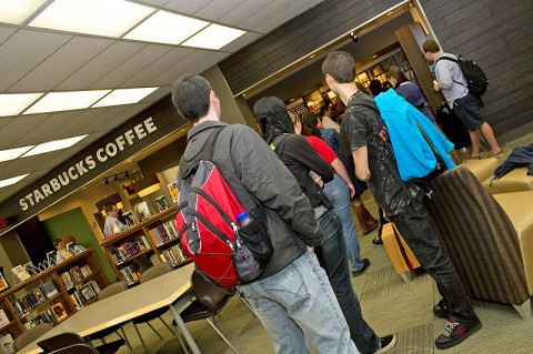 Students wait in line for the newly opened Starbucks coffee shop inside the APSU Woodward Library. (Photo by Amber Fair/APSU)