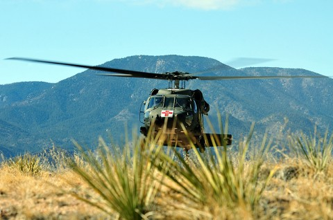 A UH-60 Black Hawk medevac helicopter with Task Force Eagle Assault, 101st Combat Aviation Brigade, 101st Airborne Division, lifts front wheels off the ground during a rolling takeoff on a confined hilltop at Fort Carson, CO during Task Force Eagle Assault's rotation to high altitude mountainous environment training, Feb. 20th, 2012. (Photo by Sgt. Duncan Brennan)