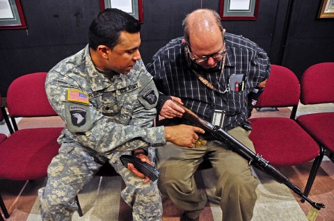 Jose Rosario, a deploying Strike Soldier from one of the Security Force Assistance Teams with the 2nd Brigade Combat Team, 101st Airborne Division (Air Assault), asks John E. Foley, the foreign weapons instructor at Fort Campbell's Don F. Pratt Museum, a question about the Ak-47 series weapon during a foreign weapons training exercise held at the museum, Feb. 27th. The Strike Soldiers were trained on foreign weapons commonly seen in Afghanistan. (U.S. Army photo by Sgt. Joe Padula, 2nd BCT PAO, 101st Abn. Div.)