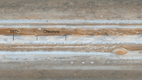 Following the path of one of Jupiter's jet streams, a line of V-shaped chevrons travels west to east just above Jupiter's Great Red Spot. (Image credit: NASA/JPL/Space Science Institute)