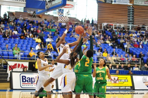 Bashaara Graves and Sierra Rozar have each others' back under the basket for a rebound. Clarksville High School Girls Basketball advances to the State Semifinals with 64-48 win over Memphis Central High School, the defending State Basketball Champs!