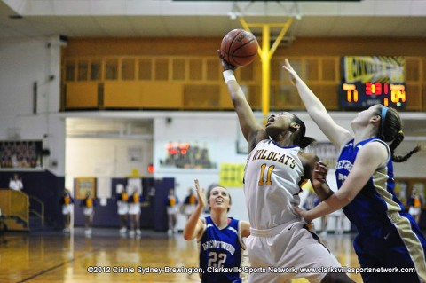 Bashaara Graves (11) grabs a rebound with one had in Clarksville High's 55-34 victory in a Sectional game on March 3, 2012, and advances to the Class AAA State Tournament with the victory.