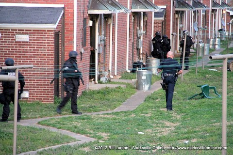 Clarksville Tactical Unit moves into position around an apartment on Ladd Street.