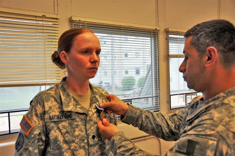 Spc. Katherine McIntire receives an Impact Army Achievement Medal for her actions in saving the life of a four-year-old boy who was choking. McIntire is assigned to the 194th Military Police Company, 716th Military Police Battalion, 101st Sustainment Brigade (photo by 1st Lt. Janet Brown, Unit Public Affairs Representative, 716th Military Police Bn., 101st Sut. Bde.)