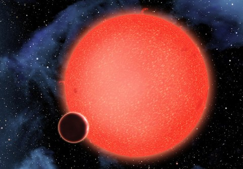 GJ1214b, shown in this artist's view, is a super-Earth orbiting a red dwarf star 40 light-years from Earth. New observations from NASA's Hubble Space Telescope show that it is a waterworld enshrouded by a thick, steamy atmosphere. GJ1214b represents a new type of planet, like nothing seen in our solar system or any other planetary system currently known. It's smaller than Uranus but larger than Earth. (Credit: NASA, ESA, and D. Aguilar (Harvard-Smithsonian Center for Astrophysics))