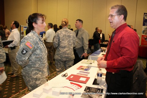 A Fort Campbell Soldier speaks with a potential employer during the two day Spring Job Fair on Fort Campbell, KY