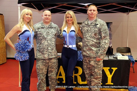 SSG Vandemark and SSG Carlson hanging out with two beautiful cheerleaders