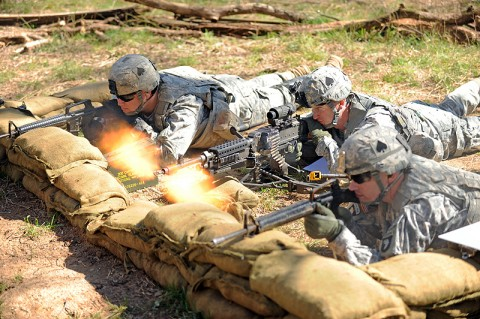 U.S. Army 1st Lt. Thomas A. Reece, a platoon leader for Company E, 2nd Battalion, 506th Infantry Regiment, 4th Brigade Combat Team, 101st Airborne Division, engages a simulated enemy opposition force with the M240B Medium Machine Gun during the Reconnaissance Lane portion of the Expert Infantryman Badge testing, March 5th, 2012 at Fort Campbell, KY. (Photo by Staff Sgt. Todd Christopherson)