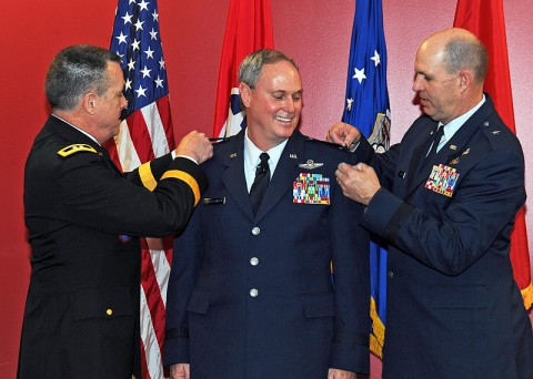 Col. Harry Montgomery, center, is pinned to the rank of Brigadier General Feb. 27th, by Maj. Gen. William Maloan, left; and Brig. Gen. Donald Johnson, right.