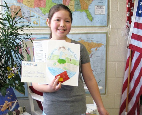 The 2012 Queen City Road Race Art Contest winner Akanee Angel from Clarksville Academy.