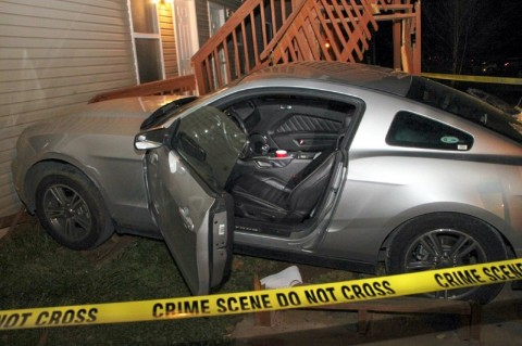 Mustang crashed hehind an apartment building after man was shot. (Photo by CPD- Jim Knoll)