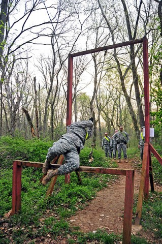 Capt. Gavin Grimm swings on a rope over a four-foot high bar during a 4-mile combat physical training course at Fort Campbell's 'Cav-Country' Mar. 22nd. Grimm said that combat focus training is a necessity and must be done. (U.S. Army photo by Sgt. Joe Padula, 2nd BCT PAO, 101st Abn. Div.)