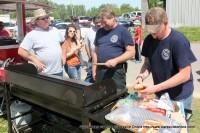 Palmyra Volunteer Fire Department cooking hamburgers and hotdogs.