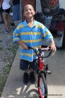 Malachi Miller standing next to his new bike.