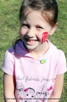 Sydney Hamilton got a rose painted on her cheek.