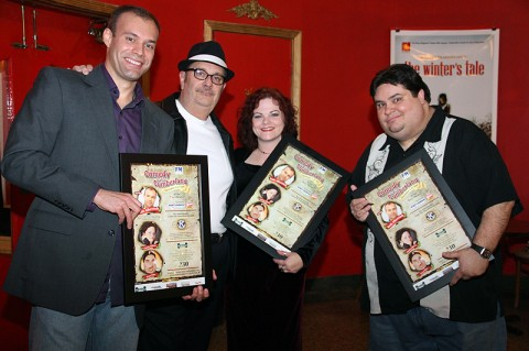 The Comedians from the December 6th, 2011 Comedy on the Cumberland show pose with their framed posters of the event given to them by even organizer Hank Bonecutter. (From left to right) Headliner Keith Alberstadt, Bonehead Promotions president Hank Bonecutter, comedian Christy Edison and comedian Brian Kiley.