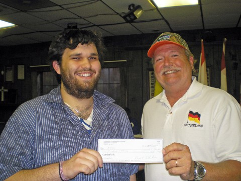 Eric Ezzell (left), who is studying German at Austin Peay State University, receives a scholarship from Jim Nolan, president of the Clarksville Edelweiss Club.