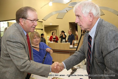CW150 Chairman Frank Lott shaking hands with Author Tom McKenney during the book signing at Fort Defiance