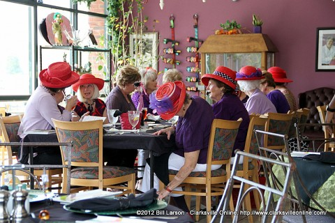 Women of The Red Hat Society enjoying Lunch at the Looking Glass Restaurant