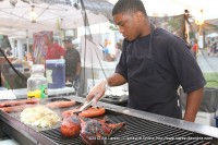 A young man grills up some of the delicious festival foods