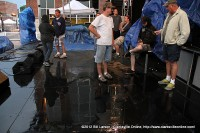 The crew of the Public Square Stage wait to see if the wet weather was going to clear up enough to resume the entertainment