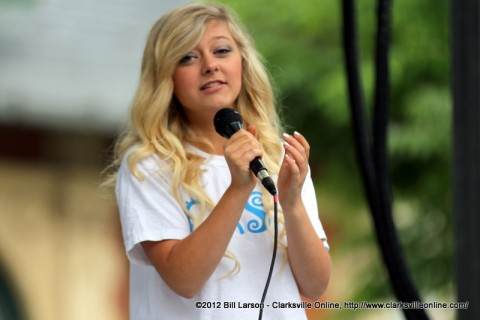 A performer from Gateway Cast and Crowns performing on the Courthouse Stage on Saturday morning