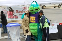CMCSS Road to Graduation volunteers pose for a pictures with Plato the Publixaurus