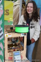 A young girl shows off Makerbot a personal 3d printer