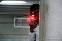 A young man snipes at his enemies during a Laser Tag Game