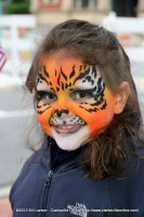 A young girl with her face painted for the day