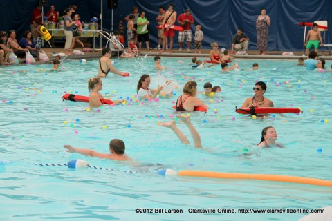 Kids gather eggs from the pool at the Indoor Aquatic Center during the City of Clarksville's Wettest Easter Egg Hunts last year.