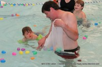 Sango Pool and Spa owner Paul Lobianco with his son during the Wettest Egg Hunt at the Indoor Aquatic Center