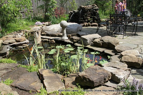 A Large goldfish pond is the center piece of the outdoor dining area