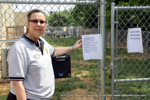 Montgomery County Animal Control Director Karen Josephson points out the no dumping signs