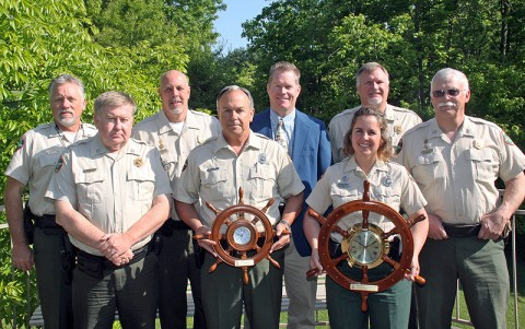The 2011 Boating Officers of the Year gathered for a photo with several of their supervisors who were present for the awards' ceremony. (Front row, from left) District 21 Capt. Jim Vaughn, Allen Herald, Pam McDonald, and District 22 Capt. Chuck Borum. Back; District 21 Lt. Jim Hooper, Darren Rider, Region II Manager Tim Cleveland, District 21 Major Cape Taylor.