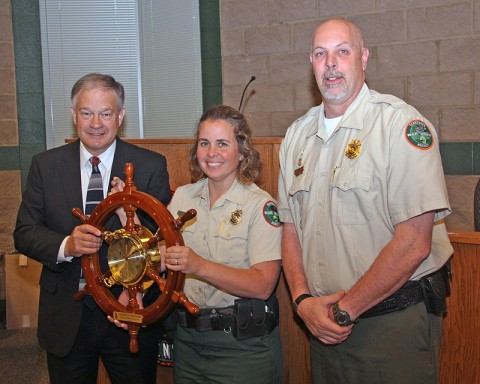 Boating Officer of the Year Pam McDonald with TWRA Executive Director Ed Carter (left) and Boating and Law Enforcement Division Chief Darren Rider. The award was presented during Friday's (April 13) meeting of the Tennessee Wildlife Resources Commission.